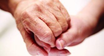 ELDER-ABUSE-holding-hands-580x360